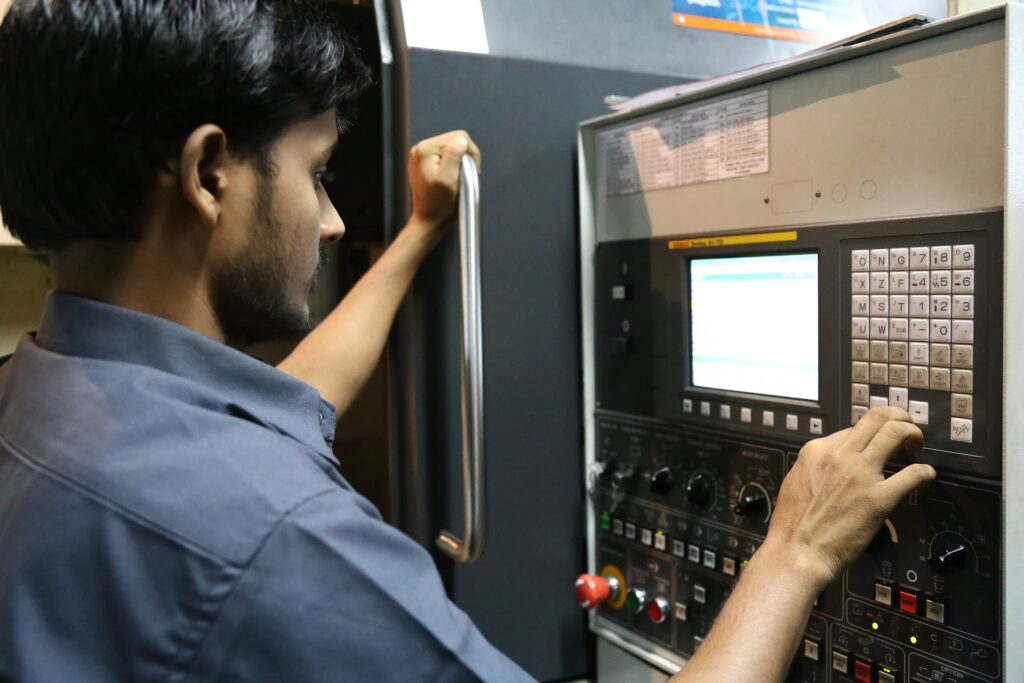 Worker using an Industry 4.0 CNC machine interface