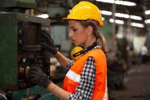 Woman Operating a CNC Machine